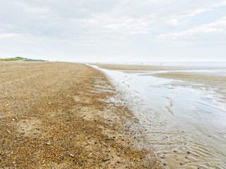The long, wide beach at Skegness is almost deserted at low tide