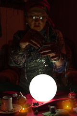 Woman fortune teller doing sorcery