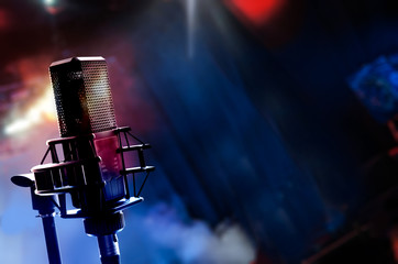Microphone on stage during concert, blurred background