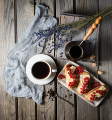 Cup of coffee with toasts and lavander leaves. Rustic