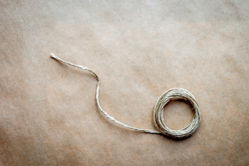 skein of twine on a background at kraft paper