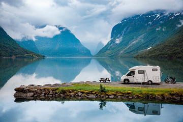 Motorhome parked over lake in mountain landscape