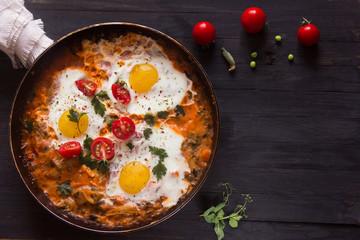 Keuken foto achterwand Gebakken Eieren three fried eggs with сherry tomatoes