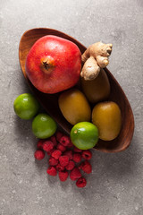 Colorful fruits  background on grey stone background