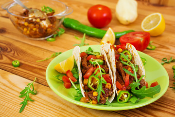 Mexican tacos with beef in tomato sauce