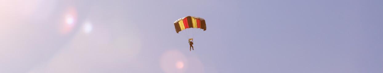 Foto auf Gartenposter Luftsport parachutist in a summer sky panorama