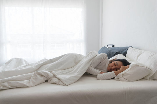 Women sleep on the bed