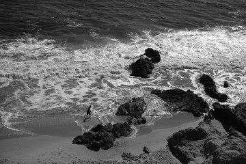 Black and white image of a beach from above.
