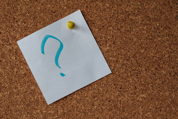 the question mark on the detachable piece of paper