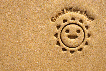 Good Morning with smiling sun on sandy beach.