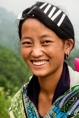 Smiling woman from Black Hmong ethnic group in Vietnam