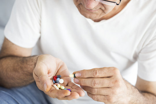 Senior man taking pills