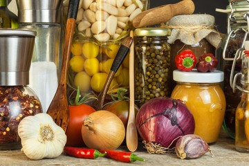Kitchen table and cooking ingredients. Vegetables and kitchen tools. Recipe for healthy food. Advertising for home cooking.