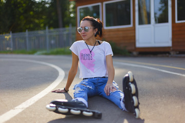 Summer girl in Park rollerblading