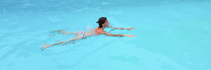 forties woman in the swimming pool
