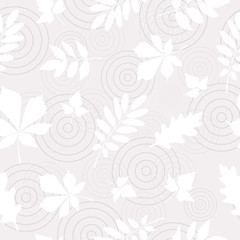 Seamless pattern of white autumn leaves on abstract puddle background.