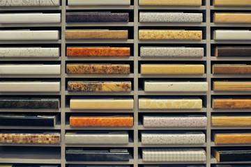 Set of flake board samples with film coating on shelf of storage
