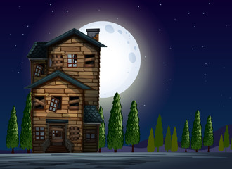 Old wooden house on fullmoon night