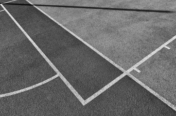 Lines on outdoor playing field, abstract sport background or texture.
