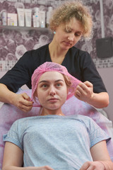 Young female at the cosmetician. Caucasian girl with problematic skin. Skin care tips from dermatologists.