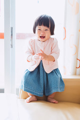 A chinese baby girl in applause