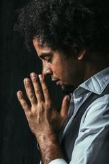 Side View of an Afro Man Praying