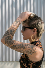 Woman with tattoo on her shoulder