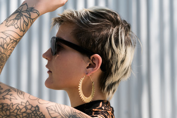 Side view of young girl with tattooed arm.