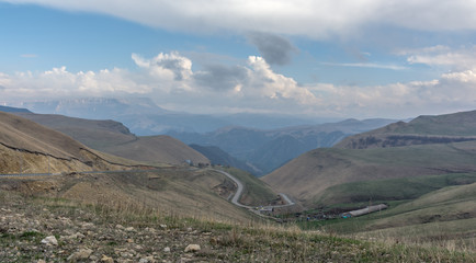 Mountain road. The North Caucasus. Cloudy summer evening.