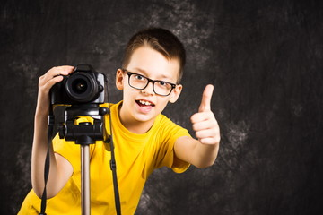 Young photographer with camera on a tripod