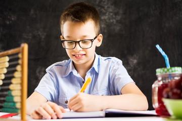 Boy doing math homework at home