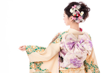 portrait of young asian woman wearing traditional kimono isolated on white background Wall mural