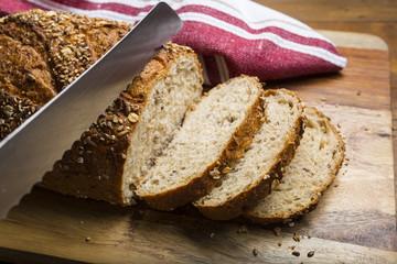 Cutting Multigrain bread into slices on cutting board