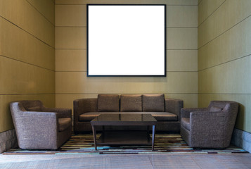 Lobby area of a hotel with blank photo frame over wood wall background , Interior gallery concept
