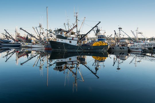 Fishing boats and reflections