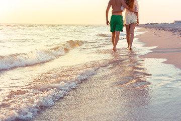 Couple taking a walk on the beach