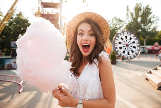 Close up portrait of a smiling girl holding cotton candy