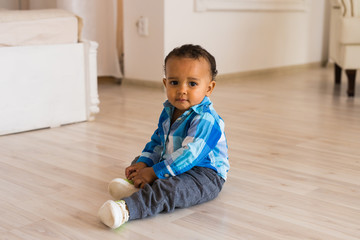 Portrait of a little african american baby boy playing indoor
