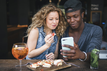 mixed race couple together in a restaurant