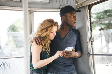 multi ethnic couple traveling on a tram