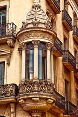 A facade of a historical building in the popular Ramblas avenue, Barcelona, Spain