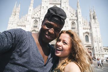multi ethnic couple doing a selfie