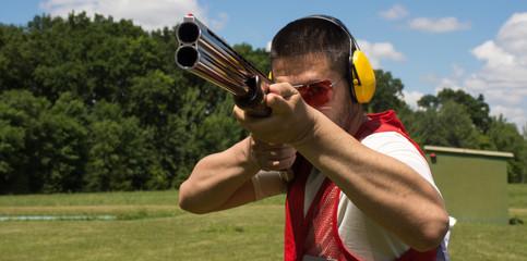 Man shooting skeet with a shotgun