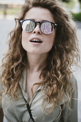 attractive young woman with reflective sunglasses