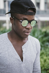 attractive black young man wearing sun glasses