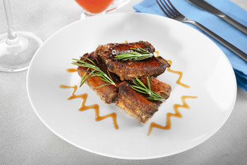 Delicious ribs served for dinner on table