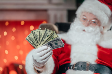 santa with dollar banknotes