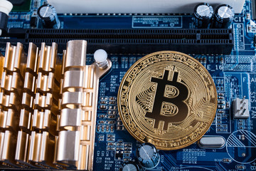 Gold bitcoin with microcircuits on a blue background. The concept of cryptocurrency..