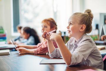 schoolgirls sitting in class