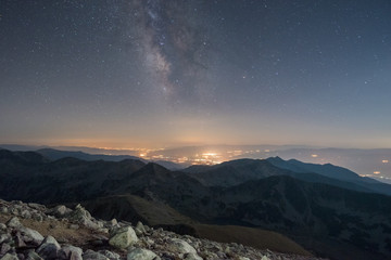 The Milky Way at night from a mountain top - typical image of solitude, relaxation and reaching high peaks